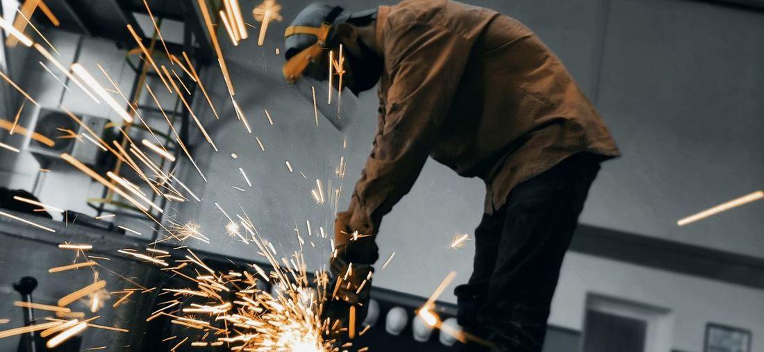 Manual worker working in workshop