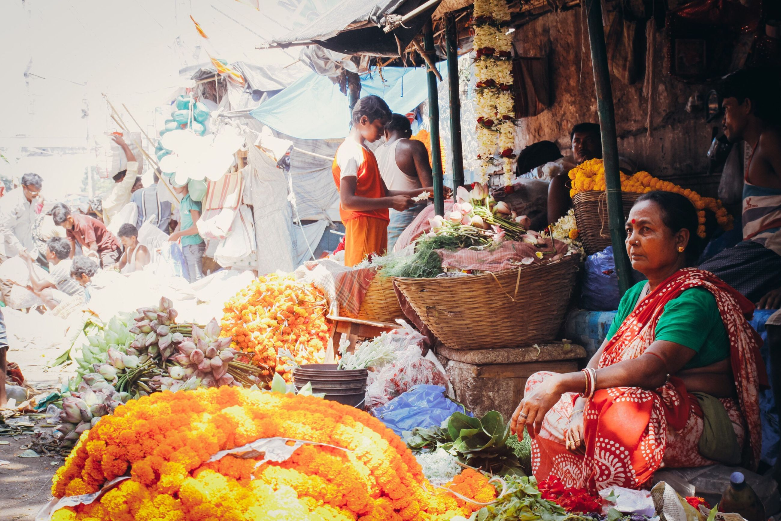freshness, variation, real people, choice, market, fruit, food and drink, men, adults only, food, market stall, outdoors, healthy eating, for sale, women, day, adult, people