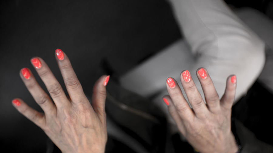 Adult Beautiful Woman Black Background Body Part Close-up Fashion Finger Focus On Foreground Front View Hand Human Body Part Human Hand Human Limb Indoors  Midsection Nail Nail Polish One Person Red Red Nail Polish Studio Shot Women