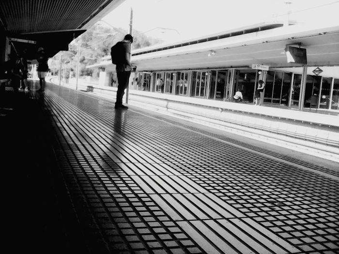 Man Waiting On Railway Station Platform