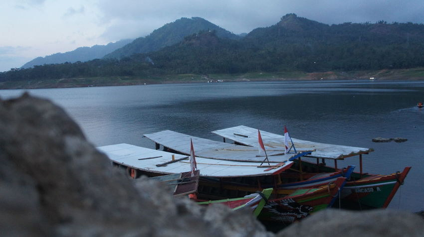 KAPAL Beauty In Nature Cloud - Sky Day Fishing Boat Mode Of Transportation Moored Mountain Mountain Range Nature Nautical Vessel No People Non-urban Scene Outdoors Scenics - Nature Sea Sky Tranquil Scene Tranquility Transportation Water