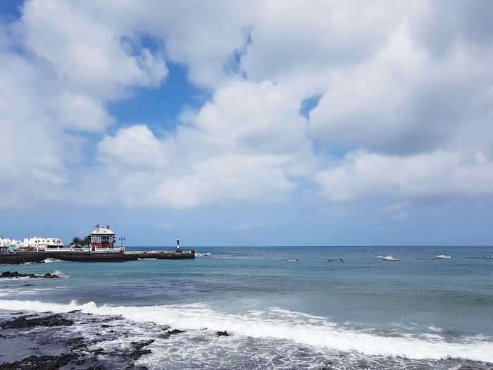 Waves Clouds And Sky Overcast Sea Canary Islands Lanzarote Island Arrecife Ocean Wave Cloud - Sky Sea Water Sky Beach Transportation Land Beauty In Nature Nautical Vessel Scenics - Nature Day Tranquility Horizon Travel Horizon Over Water Tranquil Scene No People Outdoors Travel Tranquility Travel