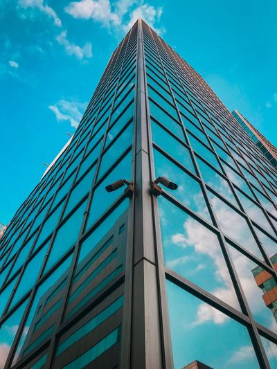 Teal and tall Architecture Building Exterior Built Structure Low Angle View Modern Sky The Graphic City