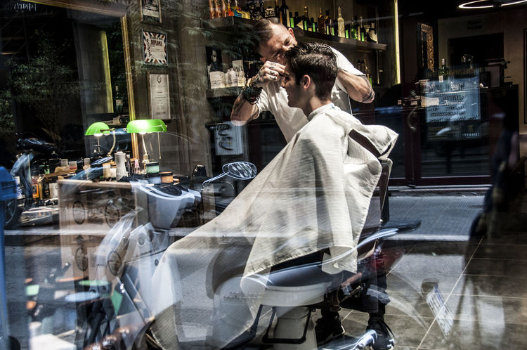 Barbershop City Life Having A Haircut Lifestyles Looking In BYOPaper! Reflection Reflexions Game Street Photography The Street Photographer - 2017 EyeEm Awards