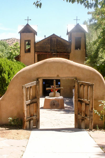 Mission Church New Mexico, USA Animal Themes Architecture Bell Tower Building Exterior Built Structure Cross Day History Mammal Mountain Nature No People Outdoors Place Of Worship Religion Sky Spirituality Sunlight Tree