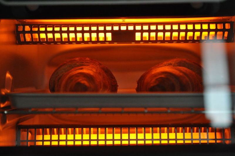 Croissants Oven Appliance Architecture Arts Culture And Entertainment Baking Tray Breads Close-up Focus On Background Heat - Temperature Illuminated In A Row Indoors  Large Group Of Objects Lighting Equipment Motion No People Orange Color Rack Railing Rehearsal Selective Focus Shelf Store Toaster The Creative - 2018 EyeEm Awards