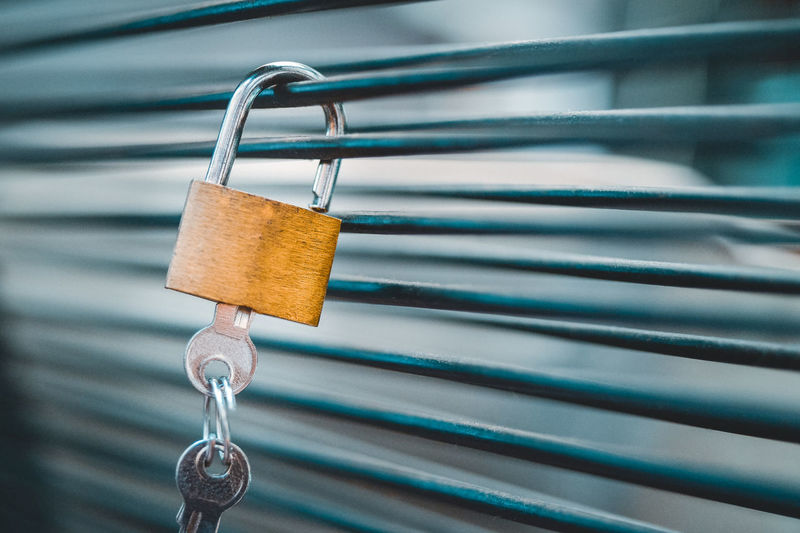 Metal Close-up Lock No People Padlock Hanging Focus On Foreground Security Protection Safety Iron Selective Focus Railing Silver Colored Keys Still Life Password Security Peace Of Mind