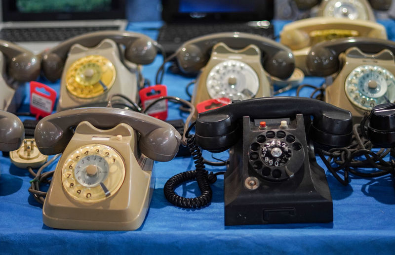Close-up of old telephones on table