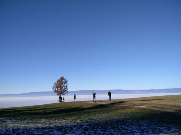Over a valley of fog Adult Adults Only Beach Beauty In Nature Blue Bonding Clear Sky Copy Space Day Friendship Full Length Grass Landscape Leisure Activity Nature Outdoors People Sky Togetherness Two People Young Adult