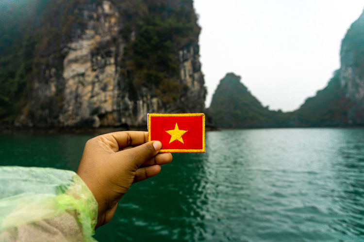 Insta: @cdombaxi Water Day Nature Outdoors Mountain Ha Long Bay Vietnam People Village Human Finger Leisure Activity Focus On Foreground Nature Human Body Part Body Part Close-up Holding Finger One Person Hand Lake Plant Human Hand