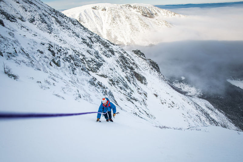 People skiing on snowcapped mountains during winter