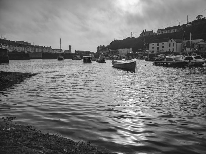 Porthleven Harbour in black and white Harbour Harbourside Porthleven Harbour Cornwall Eyeemboats Seaside_collection Blackandwhite Gig Rowing Boat Water Nautical Vessel Beach Politics And Government Sailing Ship Sky Architecture Postcard Moored Tourboat Buoy Waterfront Mooring Post Fishing Boat