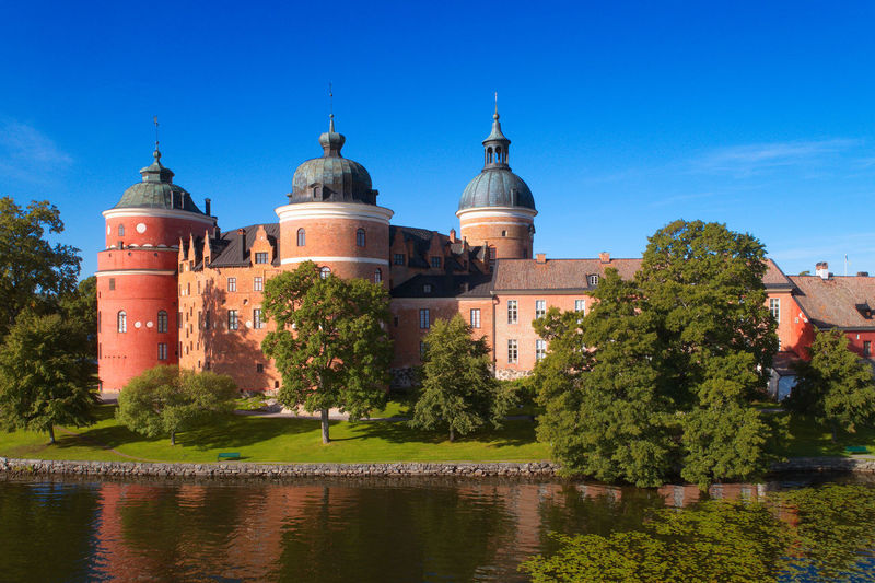 View of the Swedish 16 th century Gripsholm castle during the summer season. Beautiful Castle Famous Sweden Architecture Building Building Exterior Built Structure Clear Sky Day Dome Europe Gripsholm Castle History No People Old Outdoors Real People Reflection Summer Tourism Tower Travel Destinations Water Waterfront