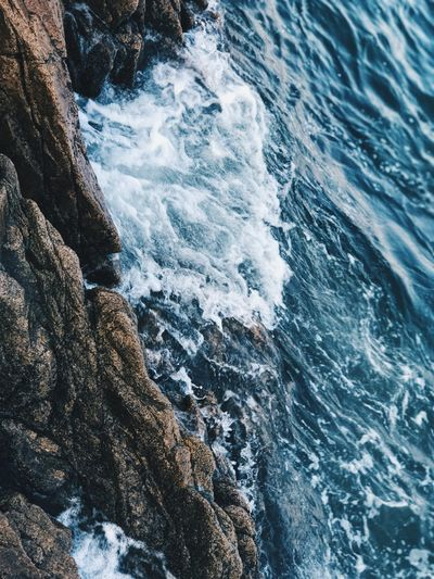 sea Water Sea Sport Beauty In Nature Motion Aquatic Sport Surfing Rock - Object Nature Sunlight Land High Angle View Rock Wave Power In Nature Beach Solid Outdoors Breaking Day