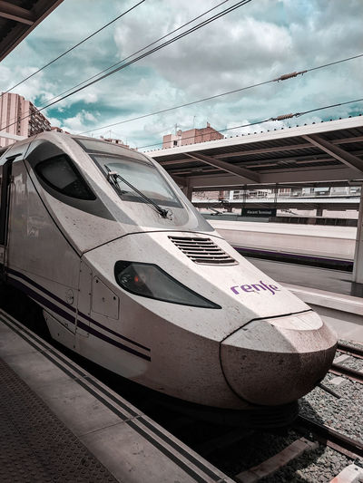 Spanish train at a station Train Train - Vehicle Train Station Renfe High Speed Train Station Railway Platform Sky Mode Of Transport Locomotive Railroad Station Platform Railroad Track Railroad Platform Railroad Station Rail Transportation Public Transportation Passenger Train Land Vehicle