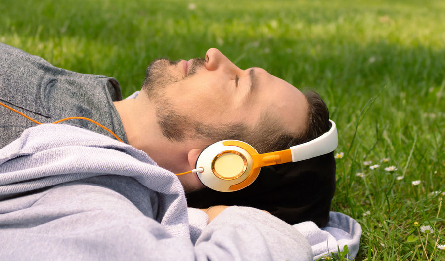 Midsection of man lying on field