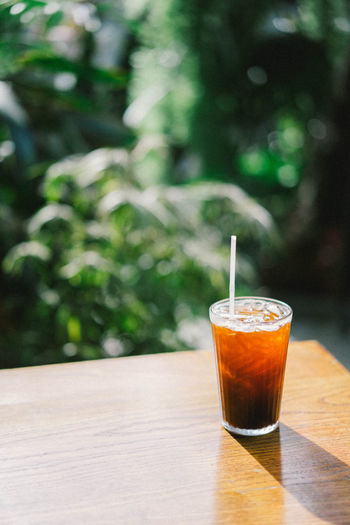 Coffee Drink Drinking Glass Food Food And Drink Glass Ice Coffee No People Outdoors Refreshment Table Wood - Material First Eyeem Photo