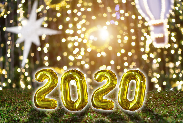 Illuminated Decoration Celebration Gold Colored No People Event Holiday Christmas Nature Green Color Plant Celebration Event Number Glowing Focus On Foreground Night Lighting Equipment Christmas Decoration Christmas Lights 2020 New Year NewYear Happy New Year