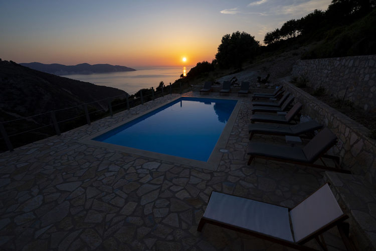 View of swimming pool at sunset