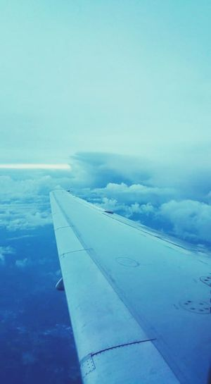 View From Above View From An Airplane Sky Clouds Airplane Wing Above Blue Sky Travel Cloudy Mode Of Transport No People Solitude