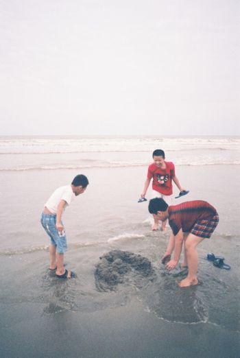 """Young boys playing with sand on the beach"" Filmphoto Film Photography Filmcamera Vietnam Samsonbeach Holiday Trip Havefunwithfriends Sand People Lifestyles Boys Beach Outdoors Nature Sea Adventure Real People"