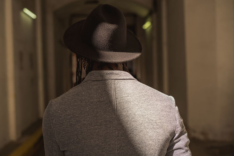 Rear view of man standing in hat