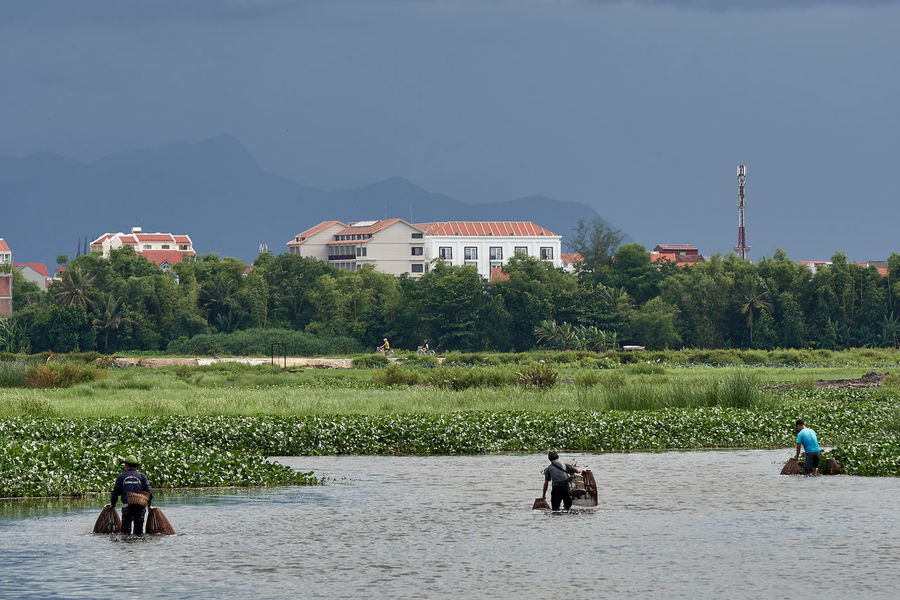 Hoi An Architecture Beauty In Nature Building Exterior Built Structure Clear Sky Day Fishing Landscape Lifestyles Men Mountain Nature Outdoors People Real People Rural Scene Sky Tree Viếtbài Water Lost In The Landscape