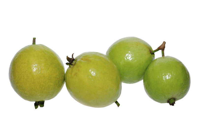 guava fruits isolated on white Fruit Healthy Eating Food And Drink Food Green Color Freshness Wellbeing Studio Shot Still Life White Background Close-up No People Indoors  Cut Out Citrus Fruit Group Of Objects Copy Space Apple Two Objects Granny Smith Apple