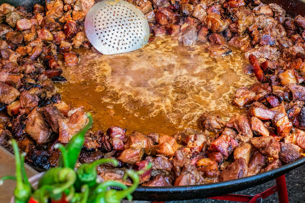 Pieces of meat fried in a cauldron Meat Food Cauldron Close-up Day Food Food And Drink Full Frame Meat Meat Fried With Garlic And Pepper Multi Colored No People Outdoors