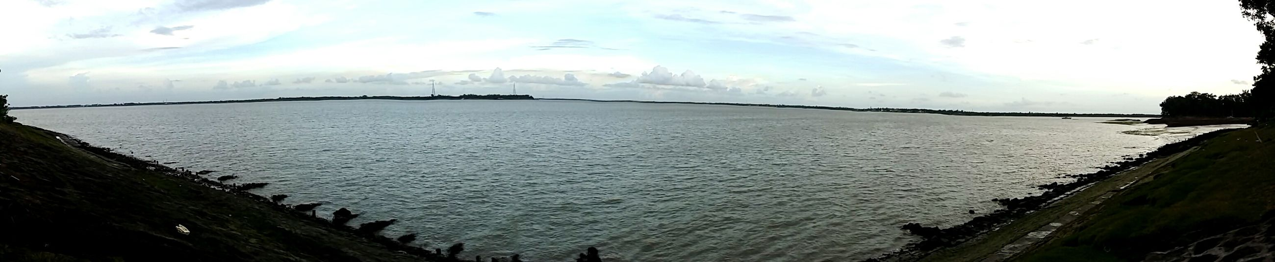 water, sky, sea, cloud - sky, built structure, tranquil scene, tranquility, architecture, scenics, nature, beauty in nature, cloudy, cloud, pier, river, building exterior, day, outdoors, panoramic, no people