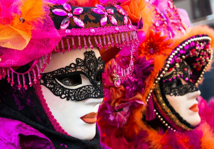 Woman wearing mask and headdress