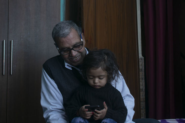 Grandfather playing with grandchild