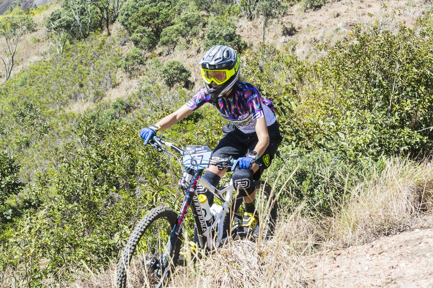 Petropolis, Rio de Janeiro - Brazil - July 8, 2017: Female cyclist participating in enduro mountain bike competition in Rio de Janeiro This Is Strength Females Enduro MTB Radical Sport Women Outdoors Headwear Helmet Cycling Adventure Day Nature Plant Ride One Person Riding Real People Lifestyles Transportation Activity Leisure Activity Sport Bicycle