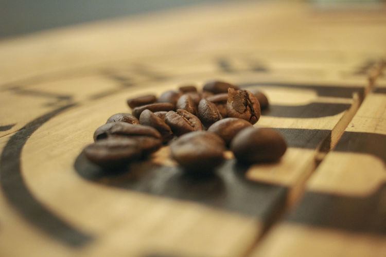 Close-up of coffee beans on table