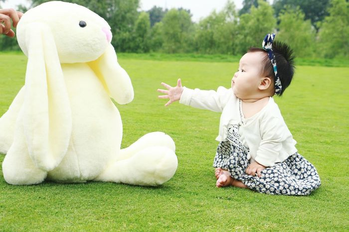 Cute Child Happiness Grass Smiling One Person Girls Children Only Fun Cheerful One Girl Only Childhood Beauty People Outdoors Pets Nature Picnic Lifestyles Sitting