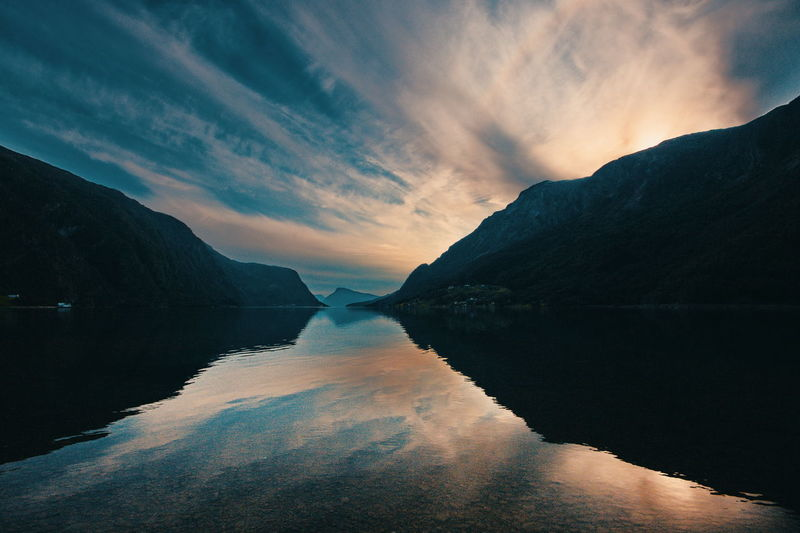 Mountain, fjord and clouds Water Sky Beauty In Nature Scenics - Nature Tranquil Scene Tranquility Mountain Cloud - Sky Reflection Nature Sunset No People Non-urban Scene Idyllic Environment Waterfront Mountain Range Silhouette Fjord Norway Scandinavia Travel Adventure Activity Hiking