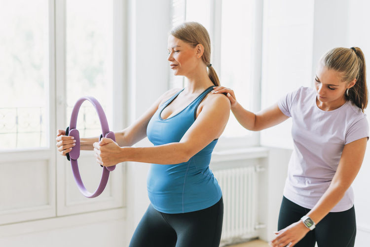 Young women exercising at gym