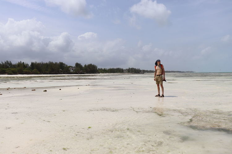 Zanzibar Adult Beauty In Nature Cloud - Sky Day Full Length Land Leisure Activity Lifestyles Nature One Person Outdoors Paradise Real People Sky Tranquility Travel Destinations Water Young Adult