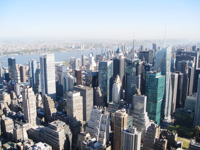 High angle view of modern buildings in city against sky new york