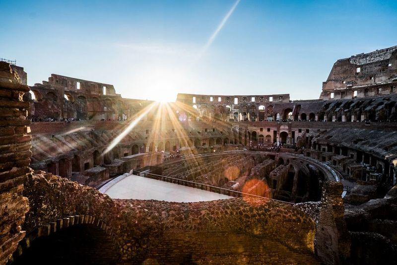 Coliseum against clear blue sky on sunny day