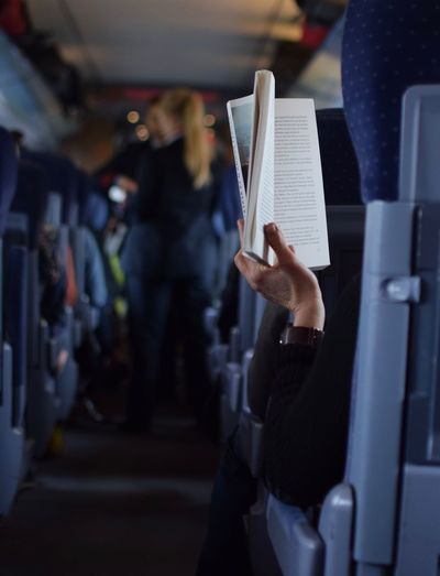 Adult Book Books Close-up Day Education Human Hand Incidental People Indoors  Men One Hand One Person People Reading Real People Train Women Connected By Travel