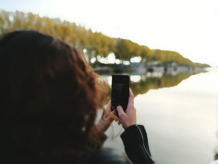 Photography Themes Photographing Rear View Technology Wireless Technology Smart Phone Communication Mobile Phone Portable Information Device Photo Messaging One Person People One Man Only Water Vacations Adults Only Only Men Outdoors Digital Viewfinder Day