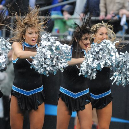 Topcats Carolina Panthers Cheerleaders  cheer during a heavy rainstorm vs the New Orleans Saints. NFL Football