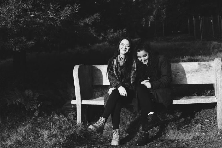 Friends Friendship Girls Laugh Laughter Laughing Bench Blackandwhite Monochrome Photography Two People Sitting Outdoors Nature Bonding Walk Autumn Full Length Real People Lifestyles Young Adult Young Women Togetherness Front View Leisure Activity Tree Women Day