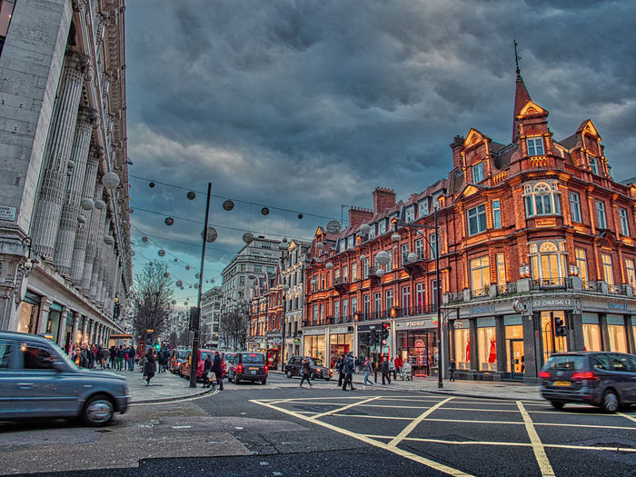 Streets of London Building Exterior Architecture Transportation Mode Of Transportation Built Structure Car Motor Vehicle City Street Sky Land Vehicle Cloud - Sky Road Building City Street Nature Sign Incidental People City Life Day Outdoors HDR Olympus Streetphotography