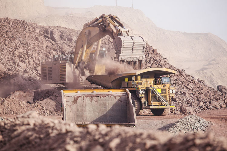 Loading of copper ore on very big dump-body truck, defocused Chile Earth Heavy Industrial Industry Minerals Road Copper  Day Defocused depth of field Dump Dump Truck Earth Mover Loading Mine Mineral Mining Mining Industry Outdoors Quarry Quarry Rock Shovel Truck Vehicle