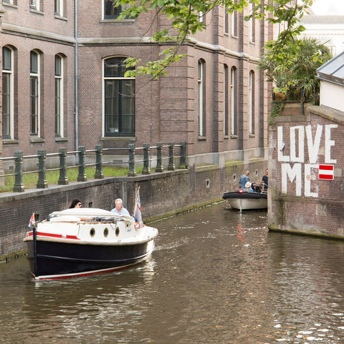 Amsterdam Amsterdam Canal Love Me Netherlands Architecture Building Building Exterior Built Structure Canal City Day Dutch Architecture Dutch Houses Group Of People Holland Incidental People Luxury Men Mode Of Transportation Nature Nautical Vessel Outdoors Passenger Craft People Real People Transportation Travel Water Waterfront