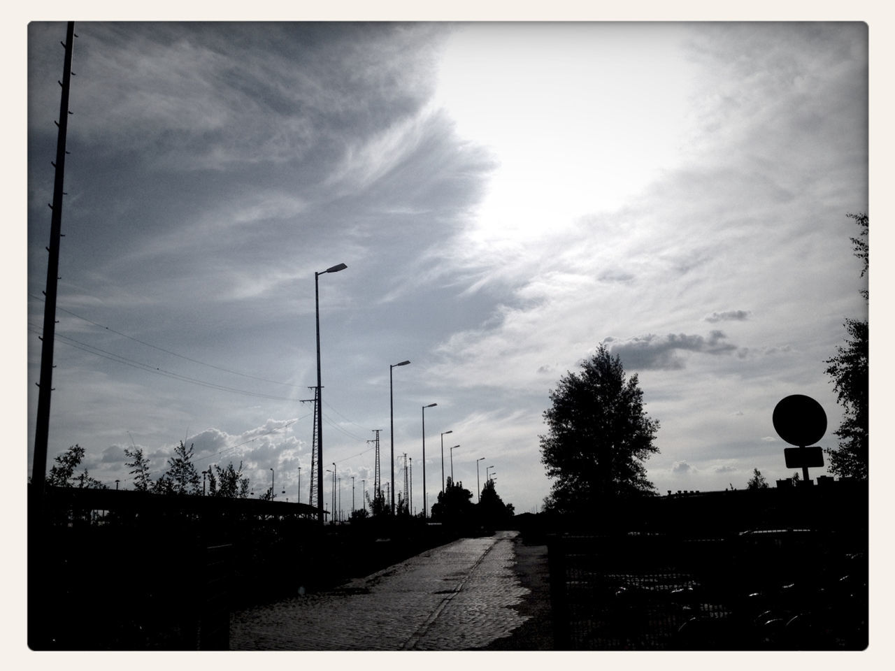 sky, silhouette, cloud - sky, car, road, transportation, street light, outdoors, tree, electricity pylon, no people, nature, telephone line, scenics, day, beauty in nature, city