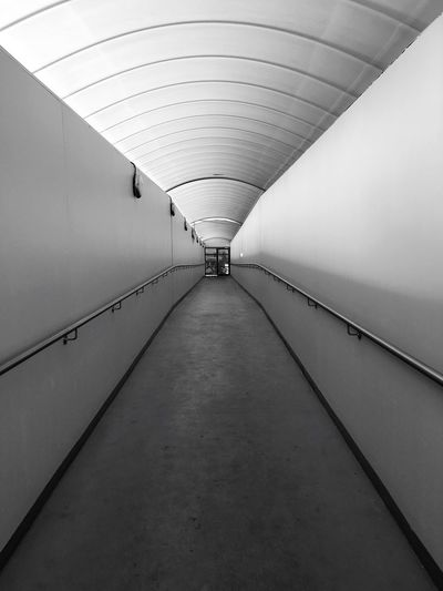 The Way Forward Direction Diminishing Perspective Indoors  Ceiling Architecture Lighting Equipment No People Wall - Building Feature Subway Tunnel Corridor Footpath Built Structure #urbanana: The Urban Playground My Best Photo 17.62°