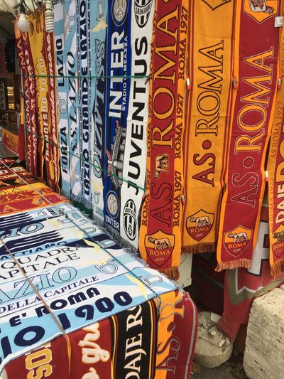 Rome, Italy - January 7, 2018: Fake AS Roma and Lazio football teams merchandising. AS Roma and SS Lazio S.p.A. are professional Italian football clubs based in Rome Merchandising Rome Supporters As Roma Choice Close-up Football Clubs For Sale Multi Colored No People Outdoors Scarves Ss Lazio